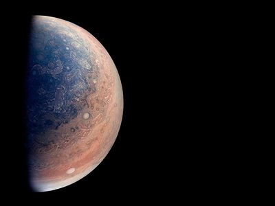 A 2018 colorized image of Jupiter's south pole created by citizen scientist Gabriel Fiset, using data from NASA's Juno spacecraft.