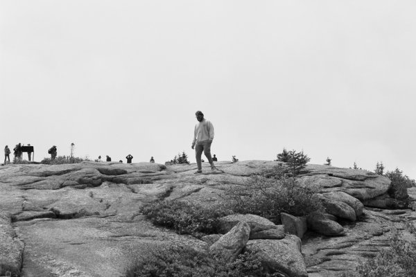 Man trekking through Cadillac Mountain thumbnail
