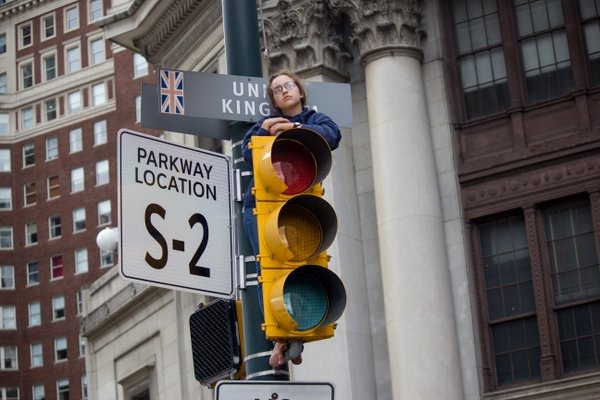 A girl on top of the traffic lights in Benjamin Franklin Parkway during Papal visit in Philadelphia. thumbnail