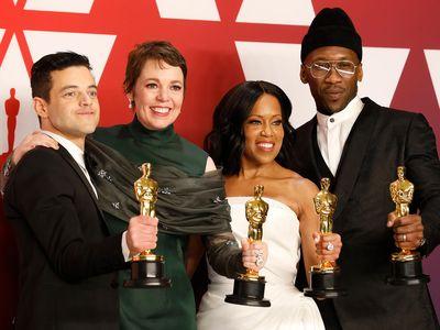 Rami Malek, Olivia Colman, Regina King and Mahershala Ali pose with the Oscars they won for acting at the 91st Academy Awards.