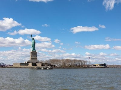 The Statue of Liberty and the new museum building on Liberty Island as seen from the approach by ferry.