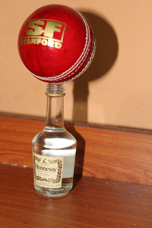 ball in top of the bottle thumbnail