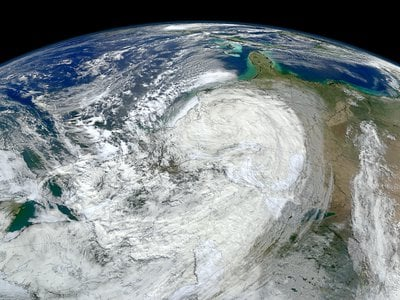 A NASA image of Hurricane Sandy moving along the United States' East Coast. Extreme weather events like this are becoming more frequent, but scientists still face challenges when attributing any one storm to climate change.