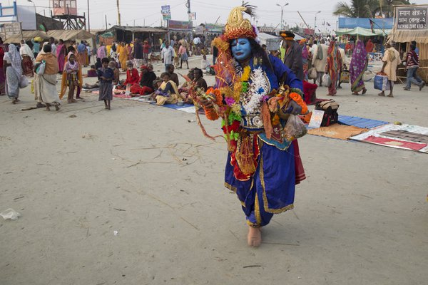 The woman is busy to beg taking makeup of Lord Krishna.  thumbnail