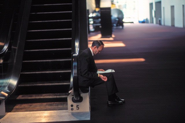 Michael Collins sits on the edge of an escalator