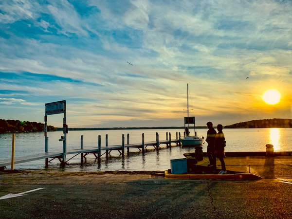 A Couple at a Stunning Sunset at the Lake thumbnail