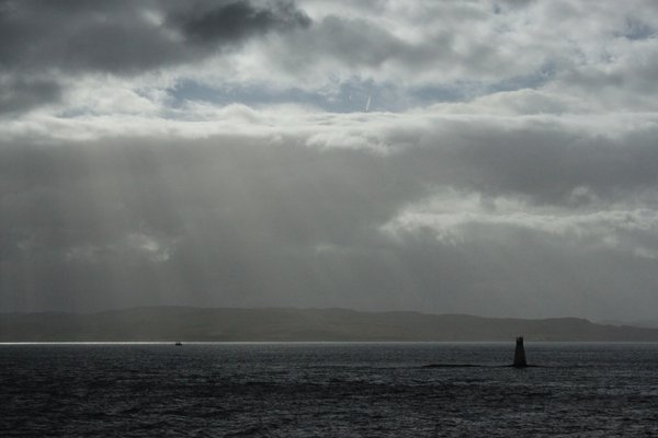 Rays of light on a lone lighthouse. thumbnail