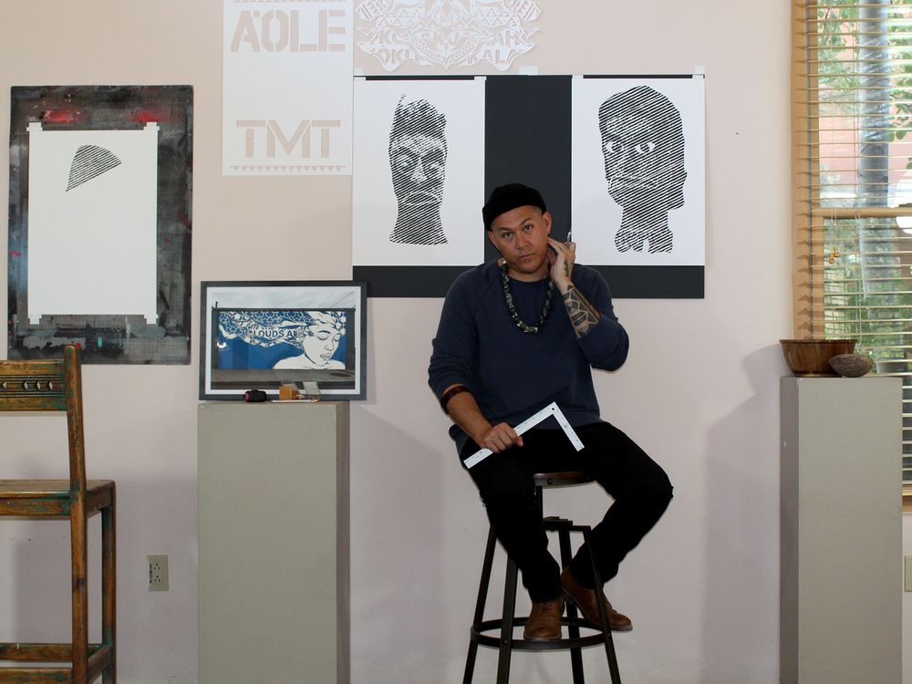 Ian Kuali'i with some of his cut-paper art, June 2019. (Courtesy of the artist)