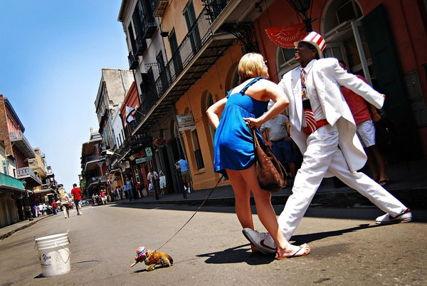 A tourist has a bit of fun with a New Orleans street actor. thumbnail