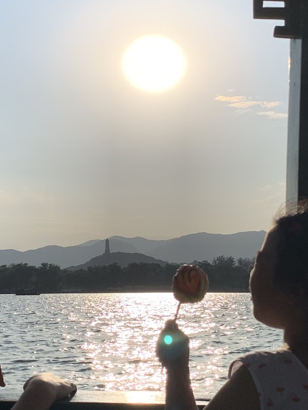 Innocence -- A child enjoying a candy during sunset in West Lake, Hangzhou thumbnail
