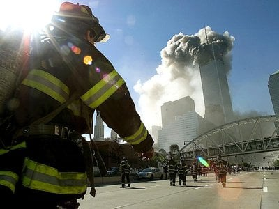 Firefighters walk towards one of the towers at the World Trade Center before it collapsed on September 11, 2001.