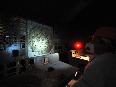 An employee of the Chernobyl Nuclear Power Plant walks in the control room of the destroyed 4th block of the plant on February 24, 2011, ahead of the 25th anniversary of the meltdown of reactor number four.