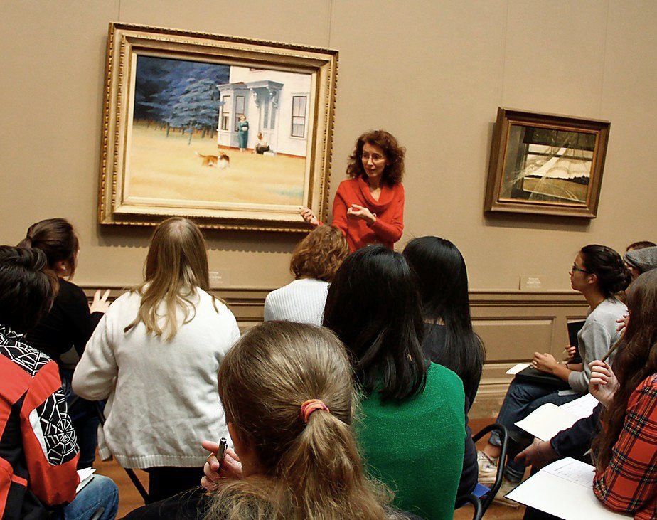 Teaching artist Mary Hall Surface stands in front of Edward Hopper's 1939 painting Cape Cod Evening at the National Gallery of Art. Surface will lead a creative writing workshop for Smithsonian Associates at the Freer Gallery of Art on March 27.