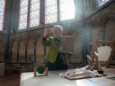 The Very Reverend June Osborne, Dean of Salisbury, takes a selfie with a laminated copy of the 1215 Magna Carta that is on display at Salisbury Cathedral.