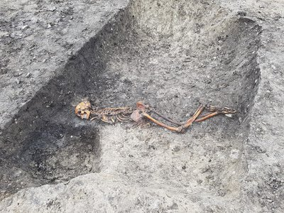 Researchers say the Iron Age man—found facedown with his hands bound together near the waist—was likely murdered or executed.