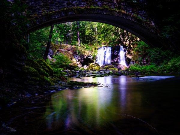 Glossy Reflections Under the Old Stone Bridge of Whatcom Falls thumbnail
