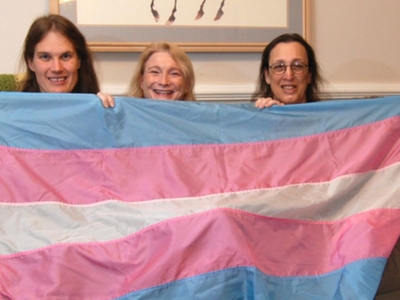Transgender flag designed by Monica Helms (right), and friends. The flag's stripes represent the traditional pink and blue associated with girls and boys and white for intersex, transitioning, or of undefined gender. Helms served in the United States Navy and became an activist for transgender rights in the late 1990s in Arizona where she grew up. She designed the flag in 1999.