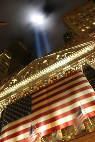 Twin-towers memorial lights as shot in front of the New York Stock Exchange on Wall Street. thumbnail