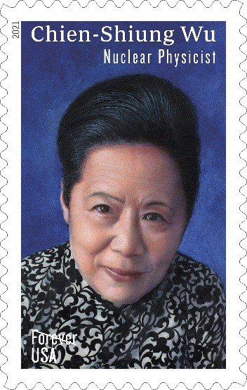 A postage stamp picturing a close up of nuclear physicist Chien-Shiung Wu. She has dark hair is wearing a black and white patterned dress.  Chien-Shiung is pictured against a dark blue background