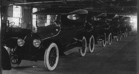 A row of brand new Cadillacs awaits drivers. 1917