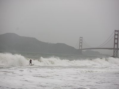 A surfer rides large waves at Baker Beach in San Francisco during one of the largest storms to hit Northern California in the last five years.