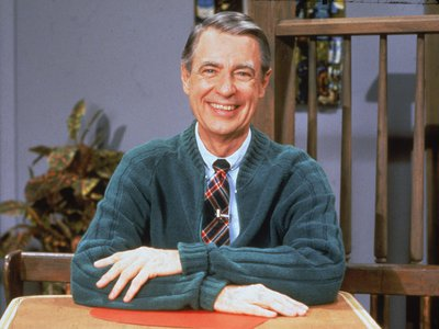 Fred Rogers, wearing his usual uniform of a cardigan and a tie, in the 1980s.