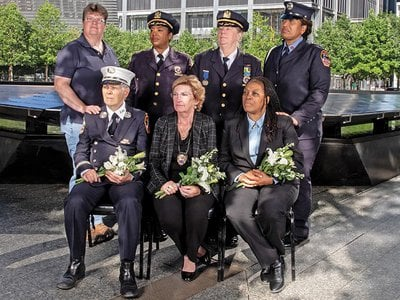 Women who responded to the call of duty on 9/11, shown at the Ground Zero Memorial in Lower Manhattan. Back row: EMT Bonnie Giebfried, NYPD Chief of Transportation Kim Royster, NYPD Chief of Interagency Operations Theresa Tobin, Firefighter Regina Wilson. Front row (all now retired): FDNY Captain Brenda Berkman, Detective Sergeant Sue Keane, Assistant Port Authority Police Chief Norma Hardy.