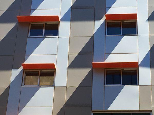 Shadows of orange window shades. thumbnail