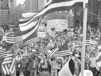 New York workers, angered by the Mayor's apparent anti-Vietnam-War sympathies, wave American flags as they march in a demonstration near City Hall in New York City on May 15, 1970.