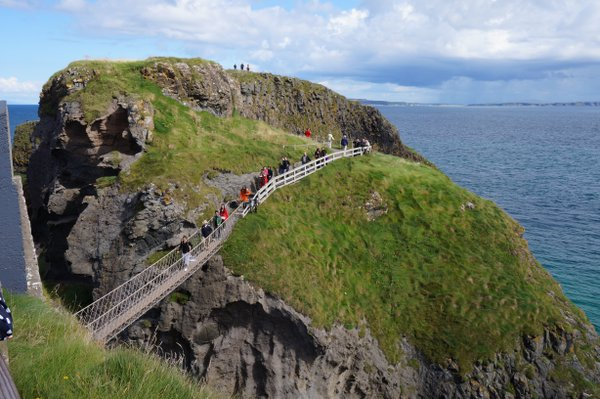 Crossing the Carrick-a-Rede Rope Bridge in Northern Ireland thumbnail