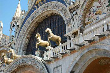 St. Mark's Basilica (above) reflects the apogee of Venetian influence: gilded ornamentation, including equine figures looted from Constantinople in 1204, caused it to be known as the Chiesa d'Oro (Church of Gold).