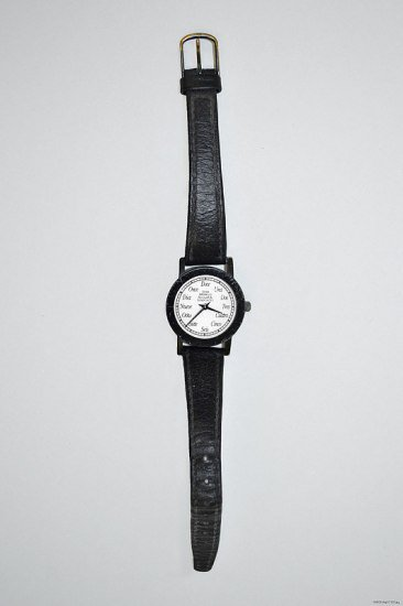 Watch with black band and white face