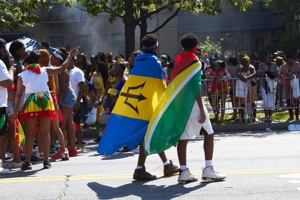 Two boys celebrating at the West Indian Day Parade thumbnail
