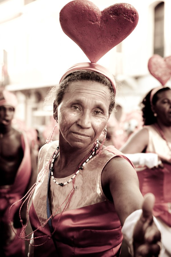 A woman offers the universal message of love at a Carnival festival in Cape Verde. thumbnail