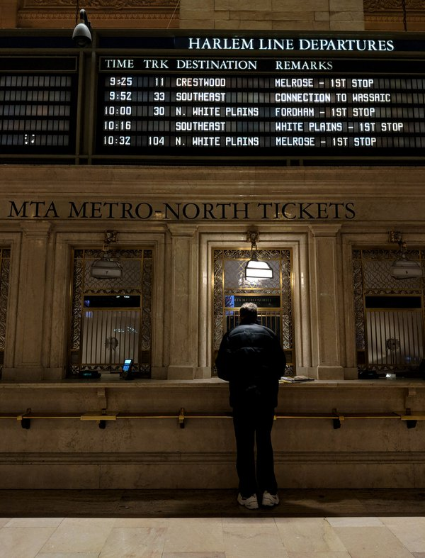 A man buys a train ticket at Grand Central Station thumbnail