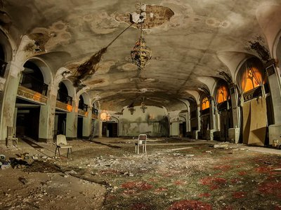 The Baker Hotel's lobby was one of the most magnificent in the nation, but after years of decay it has been left in a moldy and derelict state.