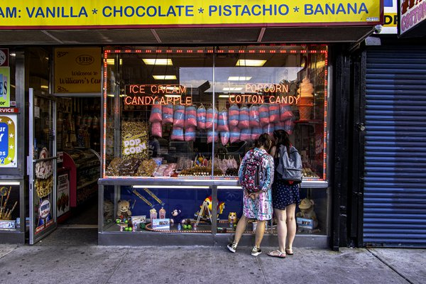 Two girls window shopping for candy near Coney Island thumbnail