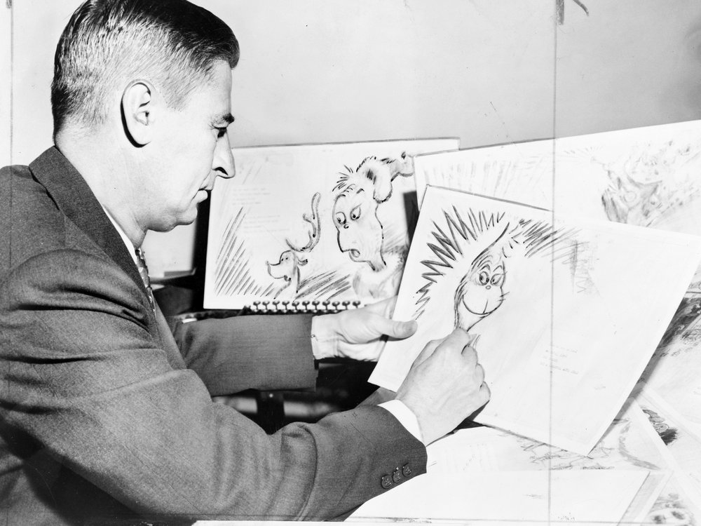 Dr. Seuss drawing the Grinch