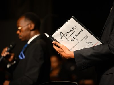 Members of the chorus sing their parts in a performance of  Antigone in Ferguson at Normandy High School in St. Louis.