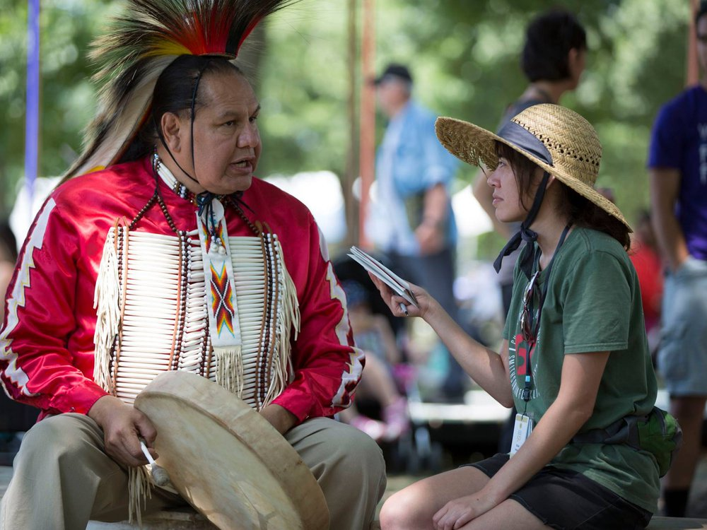 Elisa Hough interviews Dennis Zotigh (Kiowa/San Juan Pueblo/Santee Dakota), a cultural specialist at the National Museum of the American Indian. (Daniel Martinez, Center for Folklife and Cultural Heritage, Ralph Rinzler Folklife Archives.)