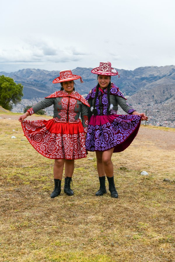 Peruvian Sisters in Traditional Outfits thumbnail