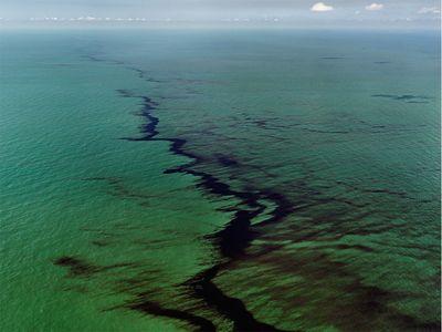 Edward Burtynsky, Oil Spill #10 Oil Slick at Rip Tide, Gulf of Mexico, June 24, 2010, chromogenic print