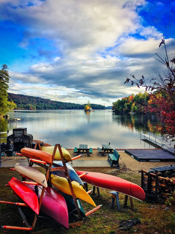 Colorful canoes lakeside during fall in New Hampshire thumbnail