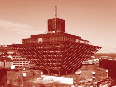 """The Slovak Radio Building, an inverted pyramid completed in 1983, has been called """"one of the ugliest buildings in the world."""" Recording studios at the center are surrounded by outward-facing offices. Its heavy weight and rough texture seem to capture the grim, waning years of Communist Party rule."""