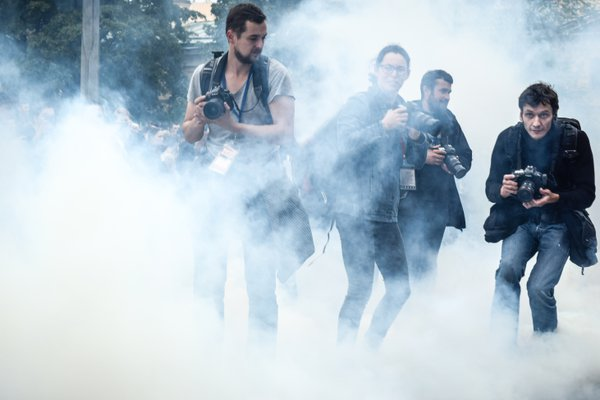 Photographers in the smoke thumbnail