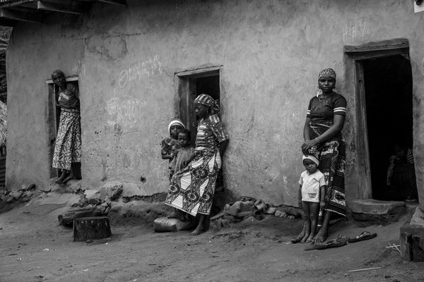 Mothers and their children standing by their doors at the Fulani village  thumbnail