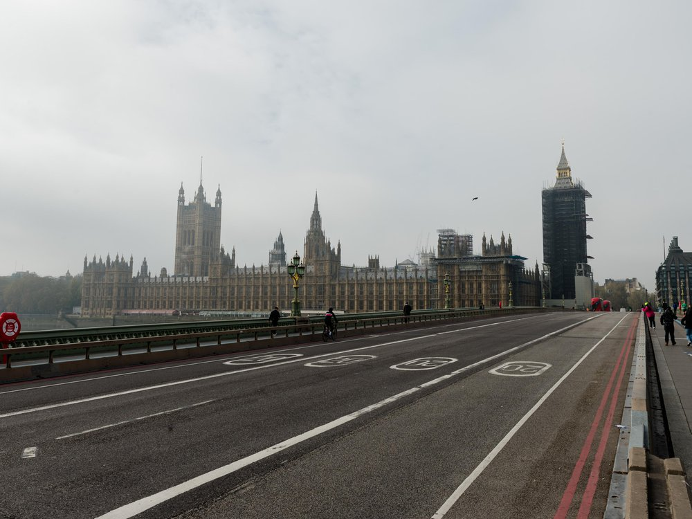 Pedestrians cross an almost deserted Westminster Bridge as England enters a four-week lockdown to tackle the spread of coronavirus, on 05 November, 2020 in London, England