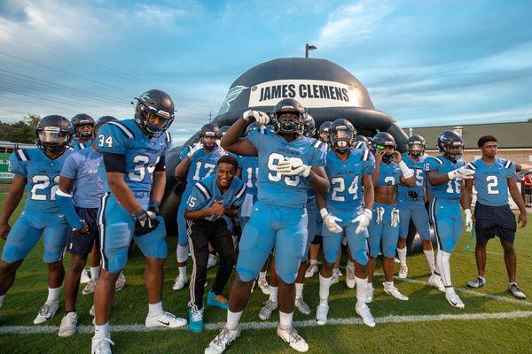 A high school football team ready for their game. thumbnail
