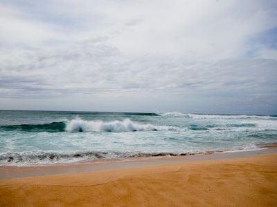 "Waimea Bay takes its name from the Hawaiian word for ""reddish-brown waters."""