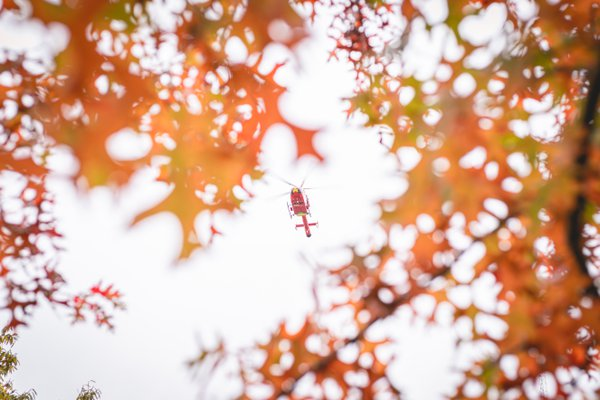 An ambulance helicopter taking off in autumn thumbnail